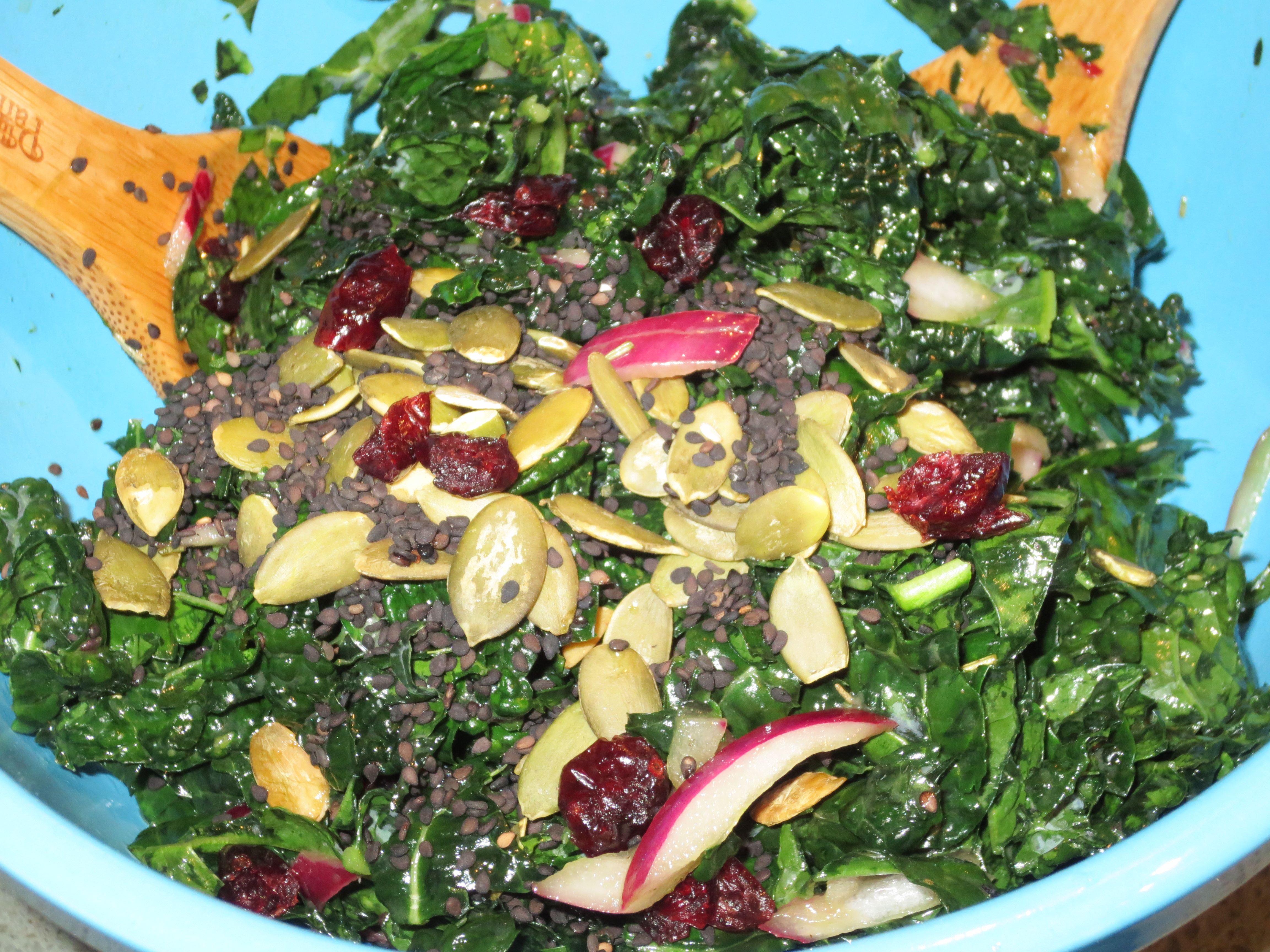 recipe: kale salad with cranberries and pumpkin seeds [9]