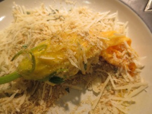 squash blossoms rolled in breadcrumbs and cheese