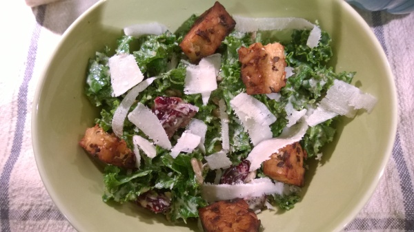 kale salad with creamy cashew dressing, tempeh croutons and shaved pecorino