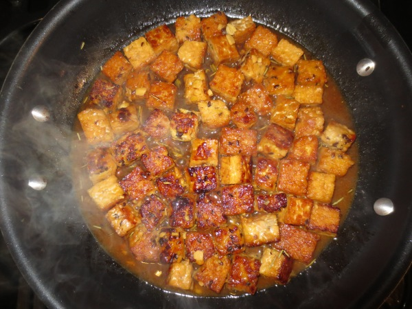 caramelized tempeh cooking in marinade