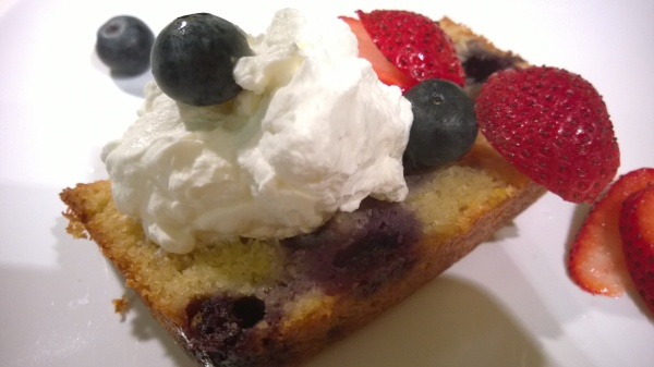 Blueberry Lemon Tea Cake with whipped cream and berries