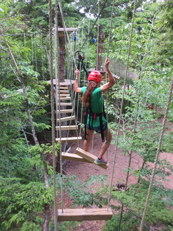 Skyler challenging the treetops obstacle course