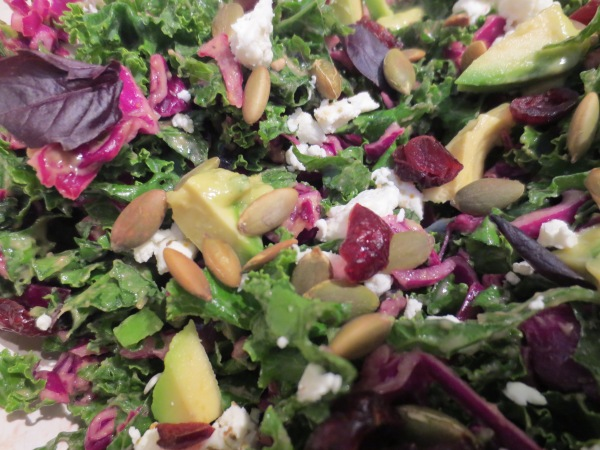 Green Kale and Purple Cabbage dressed with Avocado Fresh Herb Dressing, Cranberries, Basil, Avocado, Goat Cheese, yum!