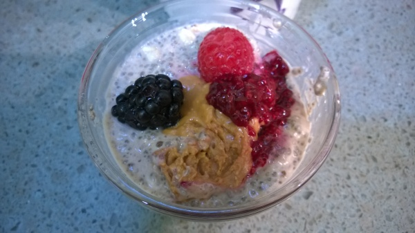 Chia Cups topped with berries, peanut butter and berry compote